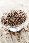 picture of flax seed  - Bowl full of brown flax seed or linseed - JPG