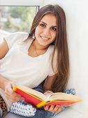Beautiful Teen Girl Reading A Book