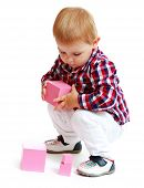 Little boy playing with blocks.
