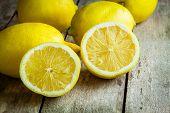 Fresh Juicy Lemons On A Wooden Background