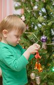 Blond Boy Decorates Christmas Tree