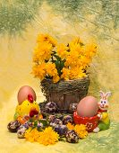 Easter Concept.  Eggs And Spring Flowers With A Figure Of Chicken And Rabbit Figure