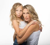 Beautiful blonde mother and daughter hugs each other