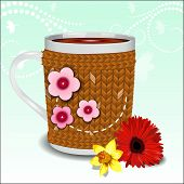Cute Cup In A Sweater Decorated With Flowers
