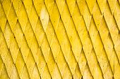 stock photo of shingles  - Yellow painted wooden shingle surface with rich texture - JPG