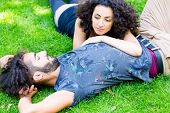 Couple, Latin man and woman, girlfriend and boyfriend, on meadow sleeping in summer