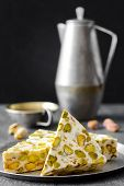 eastern traditional dessert with nuts on gray background. Selective focus