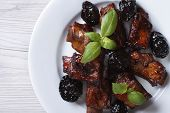 Pork Ribs Stewed With Prunes Closeup. Horizontal Top View