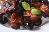 Pork Ribs Stewed With Prunes And Basil Horizontal Close-up.