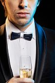 Elegant man with a champagne glass