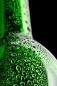 Wet green wine bottle