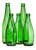 Five green glass bottles isolated on white background