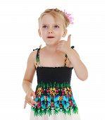 Adorable little girl gesturing.