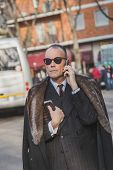 Businessman Outside Armani Fashion Show Building For Milan Men's Fashion Week 2015