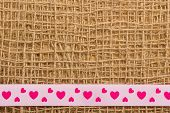 Pink Heart Ribbon On Cloth Background