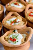 Steamed Fish With Curry Paste And Coconut Milk Topping In Clay Pot.