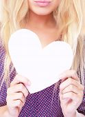 Fashionable photo of attractive woman holding in hands big white paper heart, face part, sexy lips, love concept