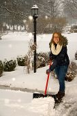 Shoveling Snow Girl At Top Of Driveway