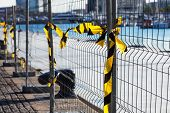 fence with ribbons on a construction site