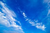 Blue sky with streaks of White clouds