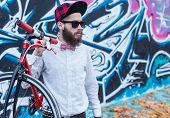 Graffiti, Hipster And A Bicycle