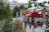 Bridge Construction Crane Topples into River