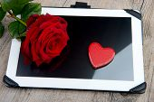 Digital Tablet With A Rose For Valentine Day