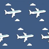 Seamless Pattern. Airplanes And Clouds Over Blue Background.