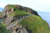 Brave hikers at the Bridge of Rope in Northen Ireland