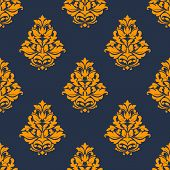 Damask seamless pattern with orange floral tracery