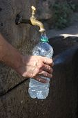 Detail Of An Arm While Filling Water