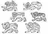 stock photo of lion  - Vintage outline profiles of noble lions with raised foreleg for mascot or heraldry design - JPG