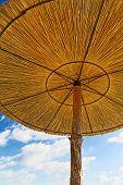 Wickerwork Sun Umbrellas On The Beach