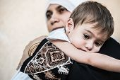 Arabic Muslim Middle Eastern woman with little son
