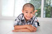 Happy kid posing on floor at home