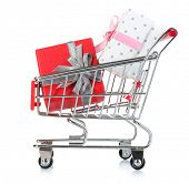 Small shopping cart full of gifts, isolated on white