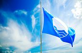 Blue Flag on Beautiful Sky Background