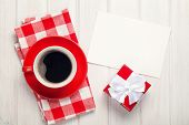 Valentines day greeting card, gift box and coffee cup over white wooden table