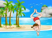A boy diving at the beach