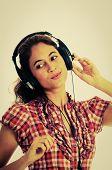 Enjoying Music On Her Headphones