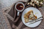 Tasty Breakfast With Pancake And Herbal Tea