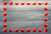 Heart frame against bleached wooden planks background