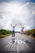 Excited couple jumping on the road against stop procastinating
