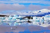 The Arctic Ocean. Iceland. Floating  ices reflected in the lagoon  Yokulsarlon