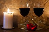 wo glasses of wine candle and teddy red heart