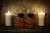 Wine glasses, candles and red heart