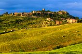 sunset view of Monticchiello, province of Siena, Val d'Orcia in Tuscany, Italy