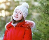 Portrait Of Pretty Girl Outdoors In Winter Forest