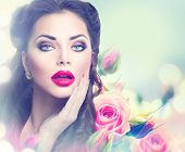 stock photo of  lips  - Retro woman portrait in beauty pink roses garden - JPG