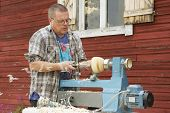 Man does carpenter work outside of his house in Korpilahti, Finland.